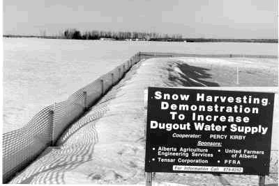 Figure 4. Plastic snow fence placed around the perimeter of a dugout