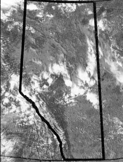 Figure 1. Satellite photo showing band of typical summer thunderstorms over central Alberta, causing isolated showers.