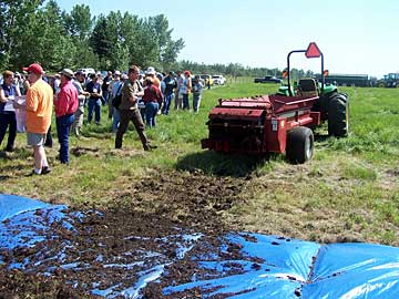 Figure 2. Collecting manure with a tarp